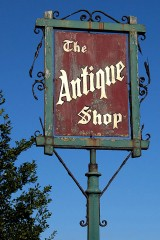 an antique shop sign